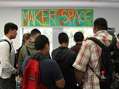 crowd of teens visiting the TeenHQ Makerspace